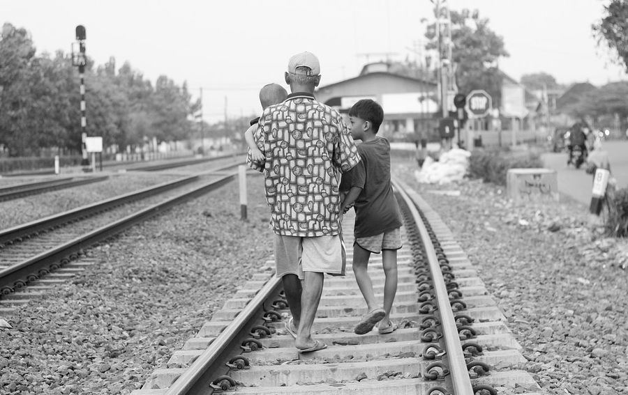 Go Home... Adult Day Full Length Men Outdoors People Rail Transportation Railroad Track Railway Track Real People Sky Togetherness Transportation Two People Walking Young Adult