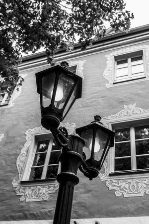 Laterne im Innenhof eines Biergartens Architecture ARTsbyXD Black & White Black And White Blackandwhite Building Exterior Built Structure Close-up Communication Day Germany Innenhof Lantern Lanterns Lighting Equipment Low Angle View No People Outdoors Street Light Street Photography Streetphoto_bw Streetphotography Technology The Street Photographer - 2017 EyeEm Awards Tree