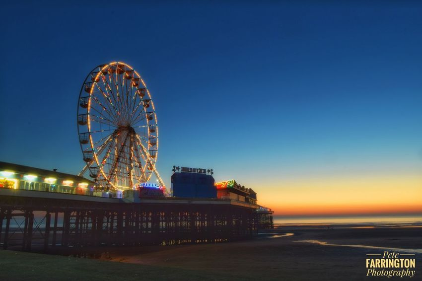 Taken a few weeks ago, the central pier at Blackpool at sunset. Lancashire UK Rotation Blackpool, England Lancashire Blackpool Seafront Blackpool Central Pier Ferris Wheel Blue Sea Clear Sky Amusement Park Water Built Structure Illuminated Night Big Wheel Architecture