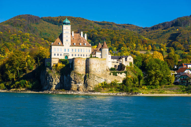 Danube river against castle and mountains