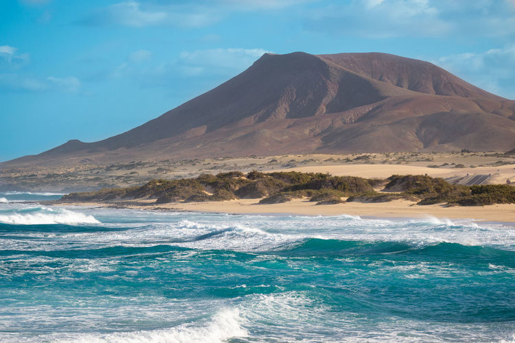 view of the burro beach, east coast fuerteventura Beauty In Nature Scenics - Nature Mountain Sky Water Sea Cloud - Sky Tranquil Scene Tranquility No People Nature Wave Idyllic Land Waterfront Non-urban Scene Motion Outdoors Volcano Power In Nature Mountain Peak