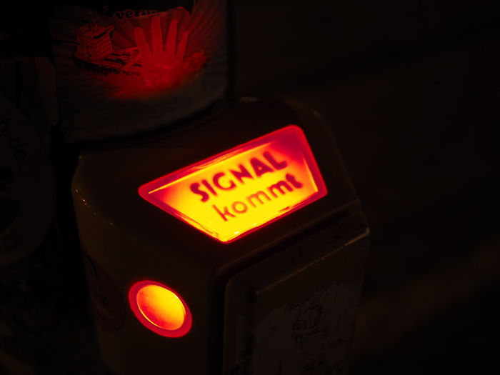 Close-up of illuminated information sign at night