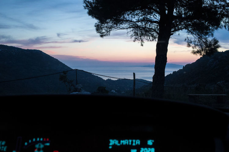 Near Zuljana village, Peljesac peninsula in southern Dalmatia, Croatia. Adriatic Balkans Beauty In Nature Car Croatia Dalmatia Hrvatska Mode Of Transport Nature No People Outdoors Peljesac Renault Scenics Sea Sunset The Great Outdoors - 2017 EyeEm Awards Through The Car Window Tranquility Tree Zuljana Summer Road Tripping