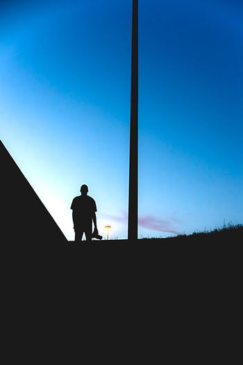 Architecture Blue Built Structure Clear Sky Copy Space Day Full Length Leisure Activity Lifestyles Low Angle View Men Nature One Person Outdoors Real People Silhouette Sky Standing Sunlight