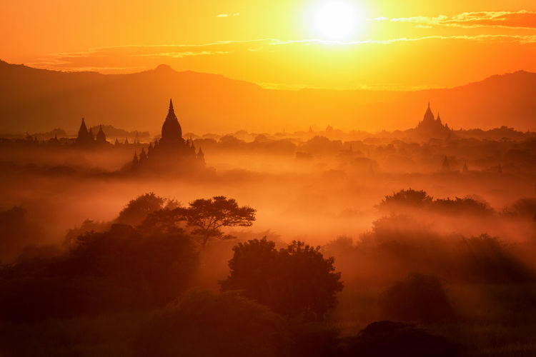 Bagan Templescape Ancient Architecture ASIA Beauty In Nature Building Exterior Built Structure Burma Day Fog History Myanmar Nature No People Old Ruin Outdoors Pagoda Religion Sky Spirituality Sunset Temple Temples Tourism Travel Destinations Tree First Eyeem Photo EyeEmNewHere EyeEmNewHere