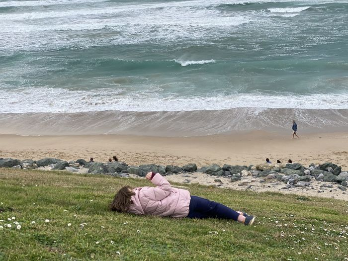 Woman on beach by sea