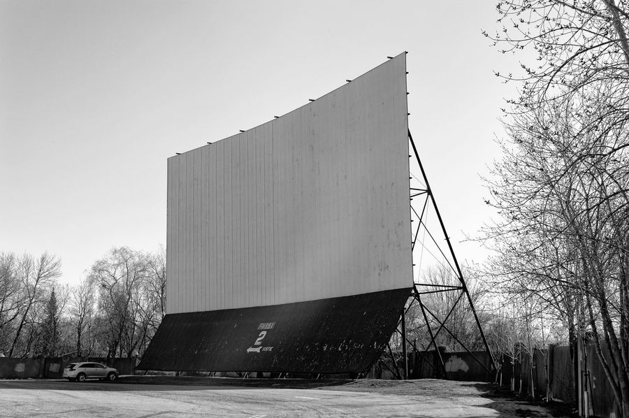 Abandoned Places Architecture B&w B&w Photography Bare Tree Black And White Black And White Photography Built Structure Cinema Clear Sky Day Drive-in Theater EyeEmNewHere MOVIE Nature No People Outdoors Screen Sky Tree