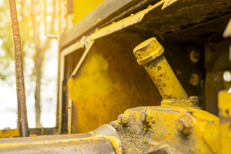 The old machinery for digging the ground in the ground. Abandoned Architecture Bad Condition Close-up Damaged Day Equipment Focus On Foreground Industrial Equipment Industry Machine Part Machinery Metal No People Obsolete Old Outdoors Rusty Selective Focus Yellow