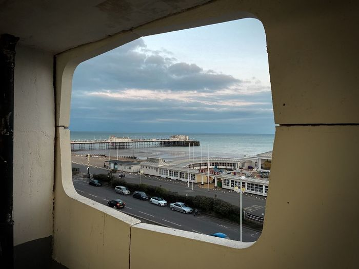 Panoramic view of sea seen through window