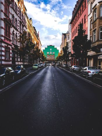 Building Exterior Architecture The Way Forward Built Structure Road Street Diminishing Perspective City Outdoors Urban Urban Geometry Urbanphotography Vanishing Point Turquoise Colored Germany Europe Offenbach Am Main Buildings Train Station EyeEmNewHere Aeroplane In The Sky Aeroplane