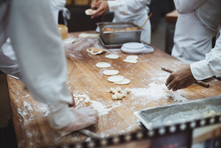 Photos from Taiwan-Trip 2017 Chef Dough Flour Food Food And Drink Freshness Hand Human Body Part Human Hand Indoors  Kitchen Making Men Midsection Occupation People Preparation  Preparing Food Real People Selective Focus Table