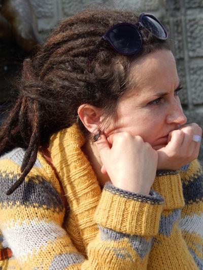 Thoughtful Woman With Dreadlocks Looking Away