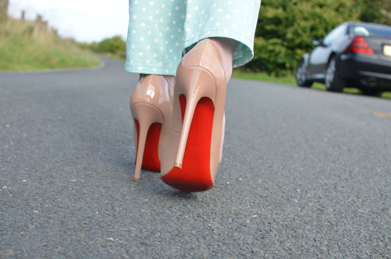 One Person Low Section Human Body Part Body Part Road Transportation Human Leg Day Shoe City Women Red Fashion Focus On Foreground Adult Asphalt Outdoors Human Limb Louboutin Heels High Heels Stiletto Walking