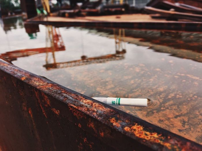 High Angle View Of Cigarette Butt Floating In Water