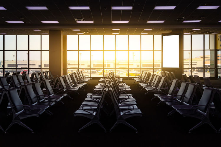 Empty seats in the departure lounge at the airport. tourism and departure concept.