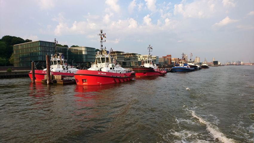 Pilot boats. Hamburg Germany Hh Elbe Elbe River River Pilot Boat Pilot Vessel Boats Hanseatic Water Wake Clouds And Sky Red Nautical Vessel Cityscape Water Sea Business Finance And Industry City Beach Urban Skyline Sky Architecture