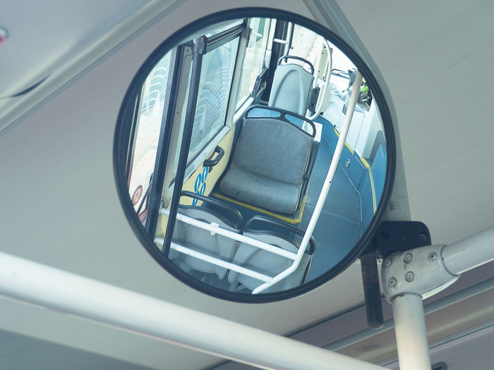 Mirror inside bus Mirror Bus Car Close-up Day Glass - Material High Angle View Inside Land Vehicle Luxury Metal Mirror Mode Of Transportation Motor Vehicle No People Outdoors Reflection Retro Styled Seat Seating Side-view Mirror Stationary Tranport Transportation Travel Vehicle Part White