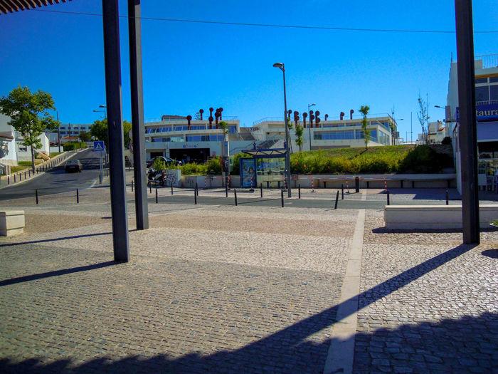Street against clear blue sky on sunny day