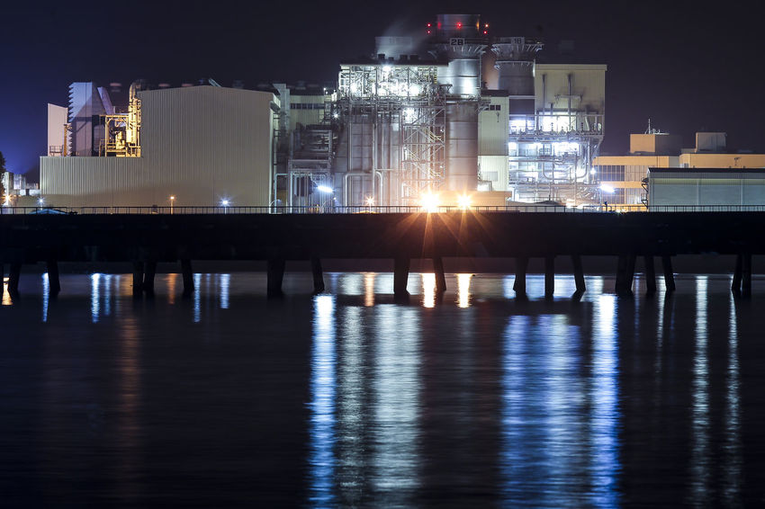 Light reflection at Power plant around the sea at night Architecture Building Building Exterior Built Structure City Factory Illuminated Industry Light - Natural Phenomenon Nature Night Nightlife No People Outdoors Reflection Residential District River Sky Water Waterfront