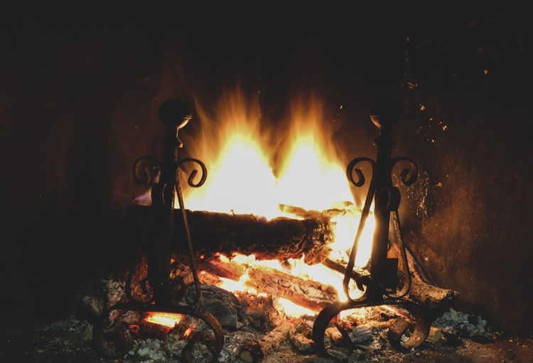 Fire on log at night