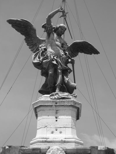 Art Cable Low Angle View Outdoors Power Line  Sculpture Sky Statue Tourism Travel Destinations