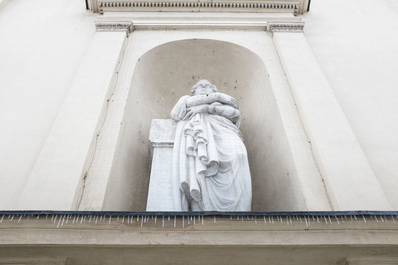 Low Angle View Of Statue At Ancient Building