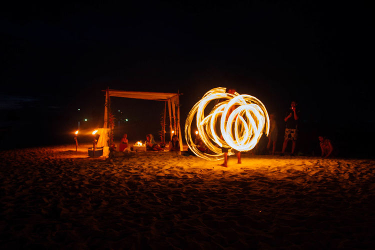 Adult Arts Culture And Entertainment Burning Illuminated Long Exposure Motion Night Outdoors People Wire Wool