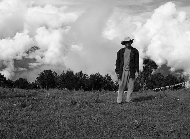 highlander Copy Space Dramatic Sky Highland Himalayas Wanderlust Above The Clouds Album Cover Bhutan Bhutanese Black And White Cloud - Sky Field Monochrome Mountain One Man Only One Person Outdoors Portrait Real People Travel Calendar Tree Line Rewilding