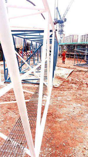 tower crane boom installation in progress Tower Crane Boom Construction Site Construction Sunlight Sky Architecture