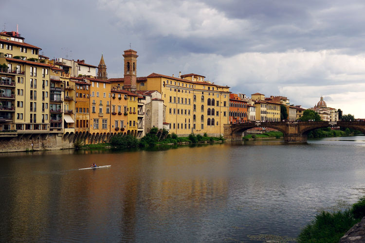Residential District By Arno River Against Sky