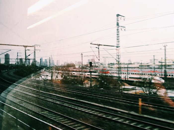 Railroad Tracks Seen Through Glass Window With Reflection