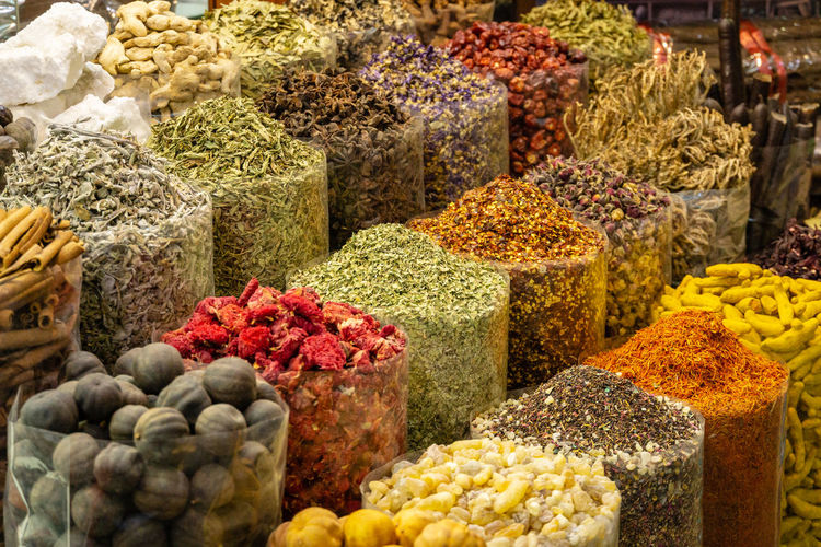 A stall in front of a shop in the Spice market (souk) of Dubai. A variety of colourful and delicious spices are on display Choice Variation Food And Drink Food Large Group Of Objects Retail  Healthy Eating No People Market Freshness Multi Colored Spices Dubai Spice Market Stall