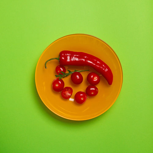 Food And Drink Food Studio Shot Colored Background Freshness Healthy Eating Indoors  Still Life Red Wellbeing Vegetable Yellow Green Color Green Background No People Directly Above Tomato Cut Out Yellow Background Kapia Chili Pepper Creativity Copy Space Cooking Ingredient Temptation Pepper