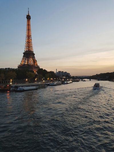 Hello from Paris Travel Destinations Architecture Tourism Tower Sunset Sky Vacations History Built Structure No People Nautical Vessel Water Urban Skyline Eiffel Tower Cityscape Boats Holiday Vanishing Point Autumn River Travelling The Week On EyeEm EyeEm Best Shots Leisure Activity City Lights