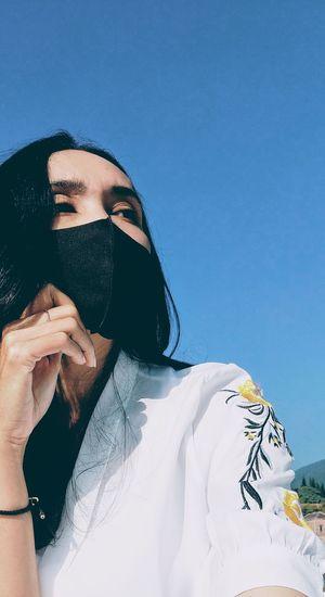 Portrait of young women against blue sky