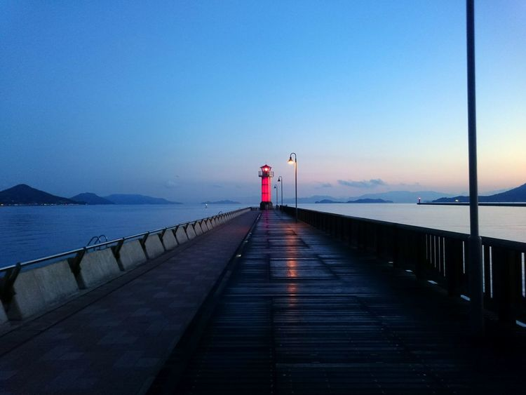 Pier Sky Outdoors Sea Horizon Over Water Clear Sky Bridge - Man Made Structure Tranquil Scene Tranquil Lighthouse Sunrise Japan Japan Photography Takamatsu Takamatsu-shi Discoverjapan Tadaa Community Live For The Story Place Of Heart The Street Photographer - 2017 EyeEm Awards The Great Outdoors - 2017 EyeEm Awards The Architect - 2017 EyeEm Awards