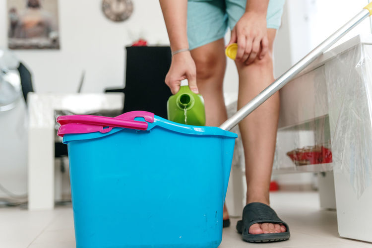 Low section of woman standing at home