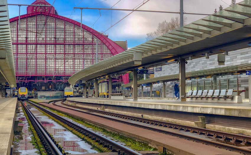 Antwerp, Belgium - Anno 2019: The train is waiting at the platform for passengers Inside the beautiful, historic and monumental Antwerp Train Station. Antwerp Central is often considered to be one of the most beautiful railway stations in the world. Track Rail Transportation Railroad Track Architecture Transportation Built Structure Public Transportation Railroad Station Sky Railroad Station Platform Building Exterior Mode Of Transportation Cloud - Sky Train Travel Nature Train - Vehicle City No People Day Modern Outdoors Station Skyscraper
