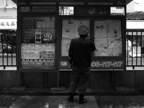 Take a look. ASIA Asian  Shanghai Wall Blackandwhite Board China Chinese City Communication Megacity News Notice Noticeboard Occupation One Person Rear View Standing Streetlife Streetphotography Supervisior Text Text Board Wall Newspaper Black And White Friday Black And White Friday Fashion Stories Stories From The City