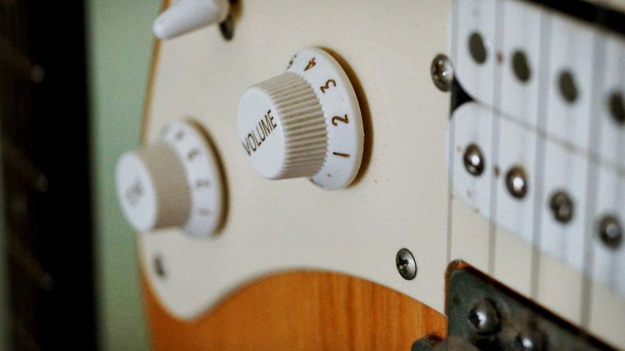 Close-up of knobs on electric guitar