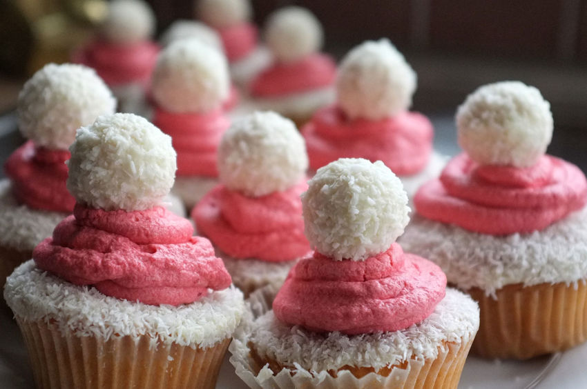 Sweet cupcakes in a christmas-design are seen in the picture. Cake Chocolate Close-up Cupcake Dessert Focus On Foreground Food Foodphotography Freshness Icing In A Row Indoors  Pastry Raffaelo Ready-to-eat Red Show Us Your Takeaway! Sweet Food Table Unhealthy Eating Street Food Worldwide