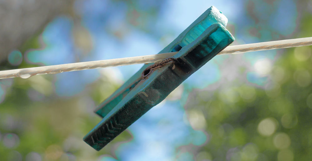 Abstract picture of an old clothespin Clothspin Abstract Art Blue Blurry Close-up Clothespin Cyan Day Focus On Foreground Lines And Shapes No People Old Outdoors Rusty