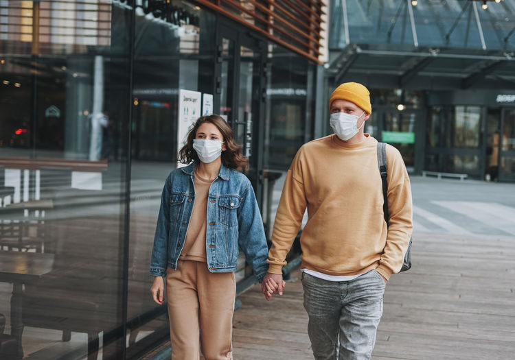 Couple wearing mask walking outdoors