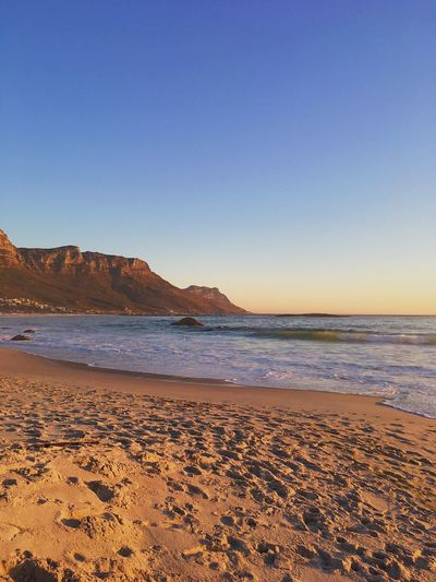 Beach at sunset, Cape Town. Beach Beauty In Nature Blue Clear Sky Day Horizon Over Water Nature No People Outdoors Sand Sand Dune Scenics Sea Sky Sunset Tranquil Scene Tranquility Water