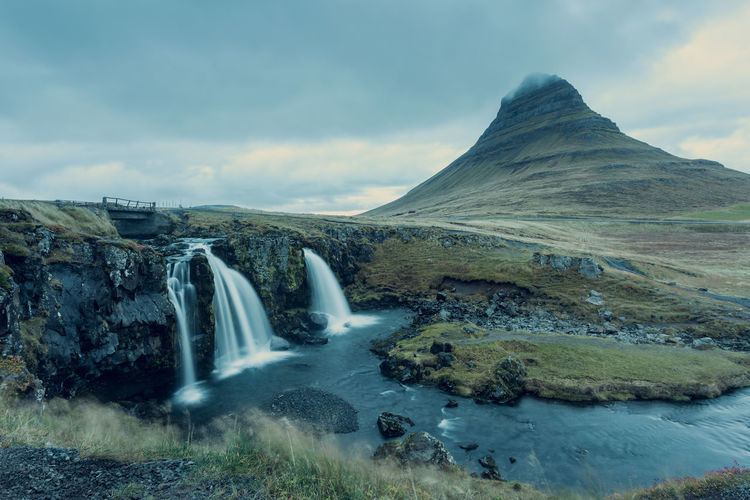 Kirkjufell mountain with Kirkjufellfoss in front Scenics - Nature Beauty In Nature Sky Waterfall Cloud - Sky Water Motion Long Exposure Environment Nature Tranquil Scene Flowing Water Mountain No People Non-urban Scene Idyllic Tranquility Blurred Motion Rock Outdoors Flowing Power In Nature Falling Water Kirkjufell Kirkjufell Mountain