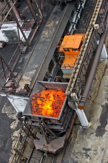 NLMK, Altai coke plant, Russia, metallurgy, wewalka coke from ovens Burning Day Fire - Natural Phenomenon Flame High Angle View NLMK, Altai Coke Plant, Russia, Metallurgy, Wewalka Coke From Ovens No People Orange Color Outdoors Transportation