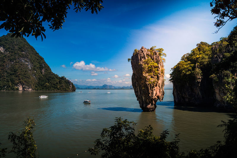 James Bond Island Phuket Water Beauty In Nature Sky Scenics - Nature Sea Rock Tranquility Tranquil Scene Tree Nature Plant Rock Formation Rock - Object Blue No People Solid Idyllic Day Cloud - Sky Outdoors Stack Rock Bay Eroded James Bond Phuket