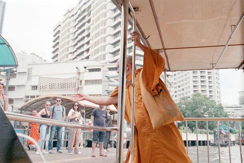 35mm Film Boat Buyfilmnotmegapixels Everybodystreet Filmisnotdead Ishootfilm Monk  Onboard Reaching Streetphotography Streetstyle The Street Photographer - 2017 EyeEm Awards