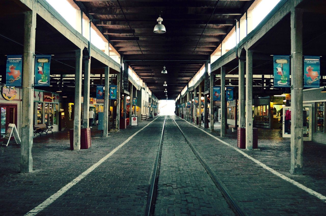 the way forward, empty, rail transportation, transportation, indoors, illuminated, no people, railroad track, architecture, day