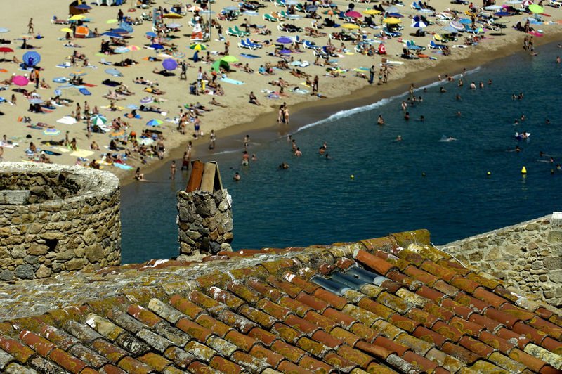 High angle view of people at tossa de mar beach seen from rooftop